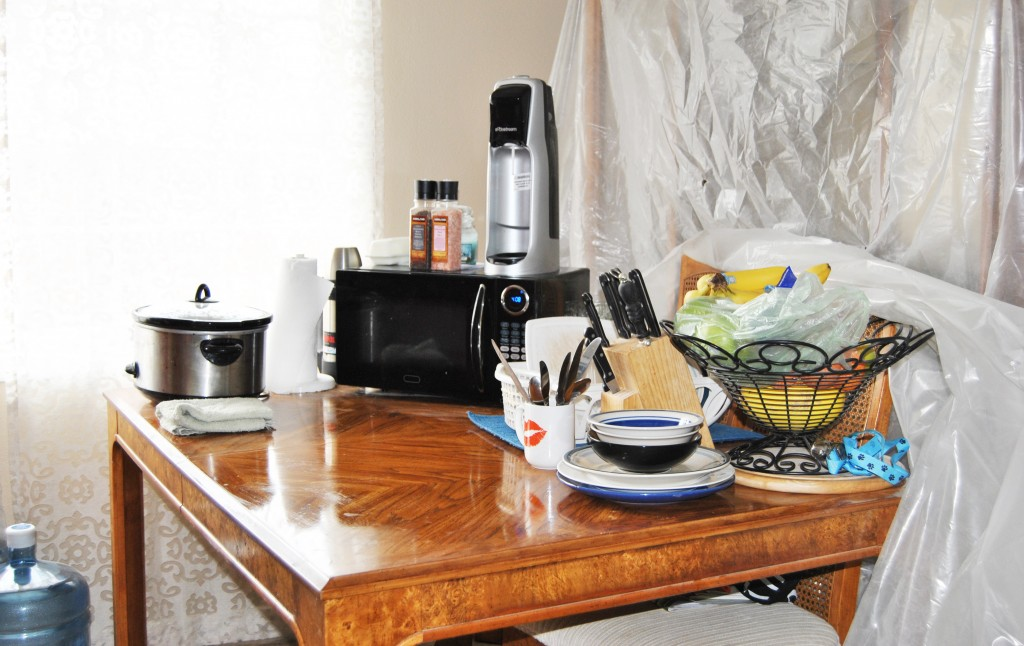 how to create a temporary kitchen during remodel. table with microwave and crockpot   bexbernard.com