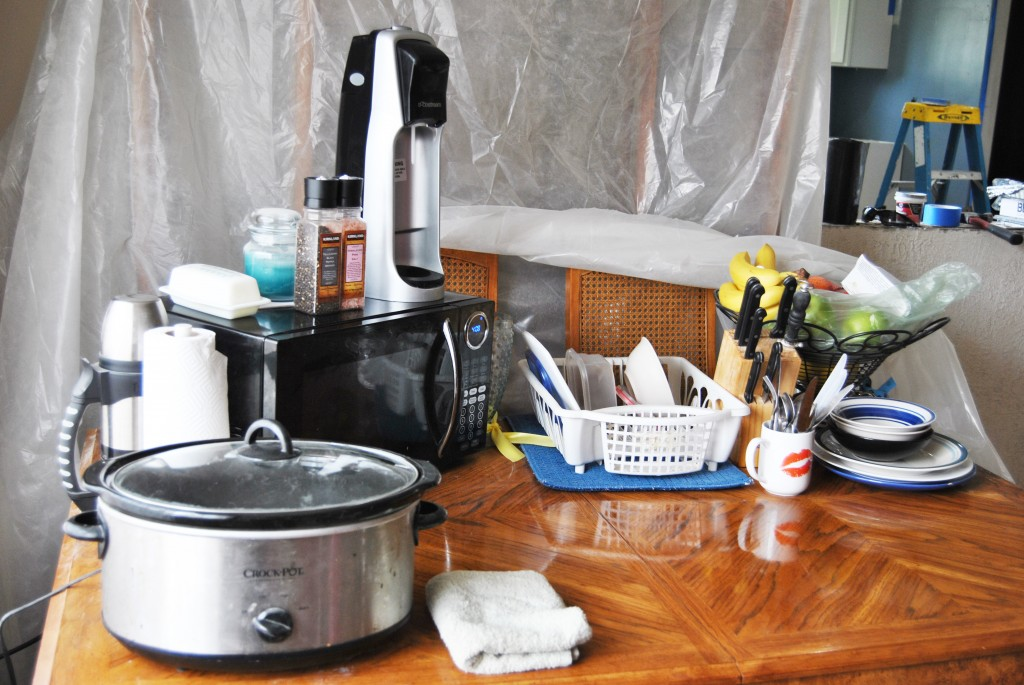 how to create a temporary kitchen during remodel. table with microwave and crockpot | bexbernard.com