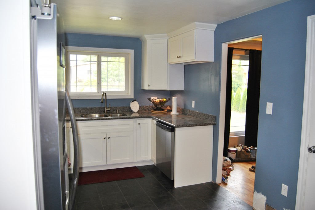 remodeled kitchen stainless steel dishwasher. white cabinets, gray floor. home improvement. renovation. house reno. | bexbernard.com