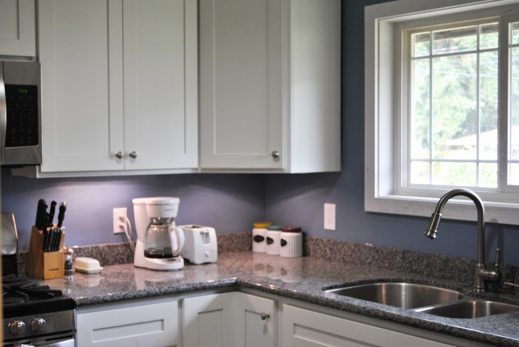 remodeled kitchen stainless steel fridge sink window. white canisters. white cabinets, gray granite counter top. home improvement. renovation. house reno. | bexbernard.com