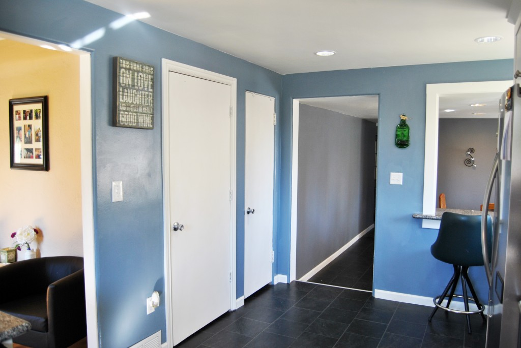 remodeled kitchen with white door to pantry. blue walls, slate gray floors. | www.bexbernard.com
