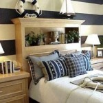 nautical bedroom decor! home makeover, home improvement with style. blue and white striped wall, anchor, ship, lifesaver, rope, lamp, headboard. http://jennajackson.hubpages.com/hub/Creating-a-Bedroom-Decor-Around-Nautical-Bedding#