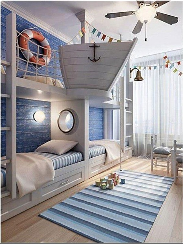 nautical bedroom decor! home makeover, home improvement with style. perfect for a little boy's room. anchor and ship coming from wall between beds. life saver, portholes, blue rugs. http://nauticalcottageblog.com/2014/03/creative-whale-art-nautical-kids-room/