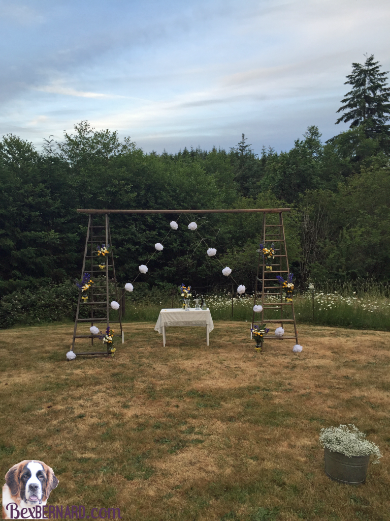 Wood arch at a rustic nautical wedding in Pacific Northwest with anchor decorations and hay bales.   bexbernard.com