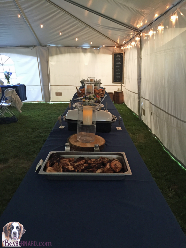 Catering menu and buffet layout at a rustic nautical wedding in Pacific Northwest with anchor decorations and hay bales.   bexbernard.com
