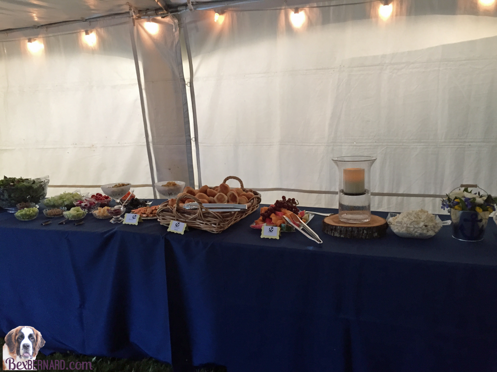 Catering menu and buffet layout at a rustic nautical wedding in Pacific Northwest with anchor decorations and hay bales. | bexbernard.com