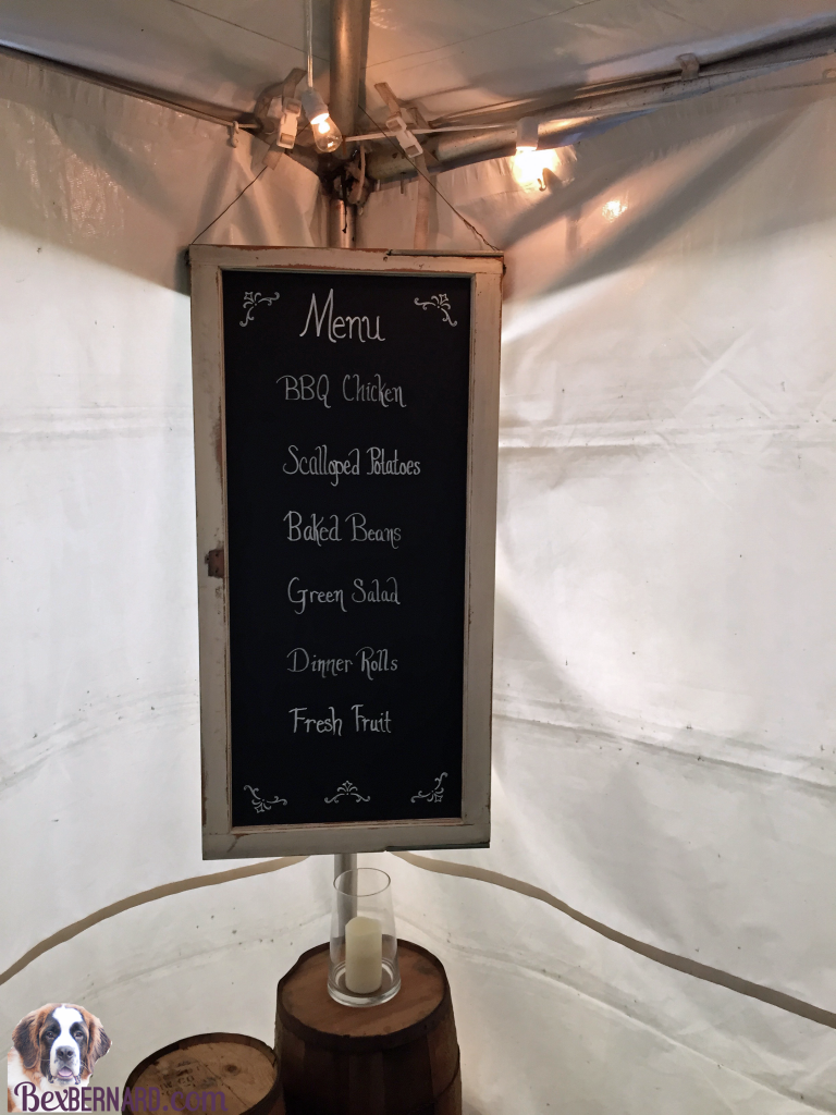Chalkboard window menu at a rustic nautical wedding in Pacific Northwest with anchor decorations and hay bales. | bexbernard.com