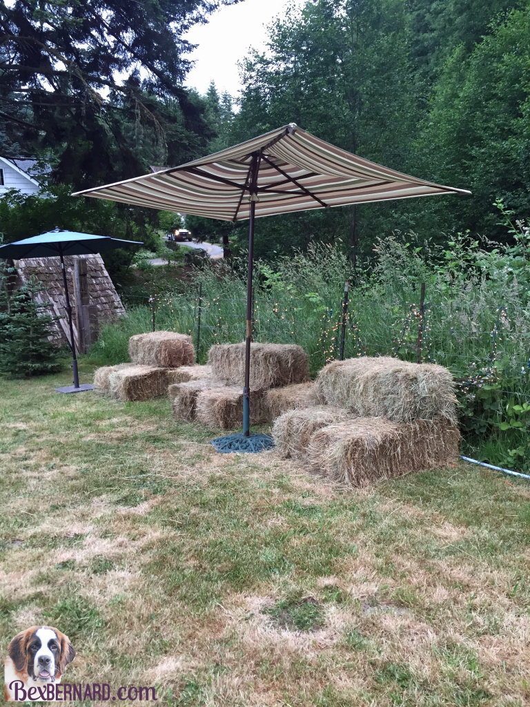 Hay bale seating at a rustic nautical wedding in Pacific Northwest with anchor decorations and hay bales. | bexbernard.com