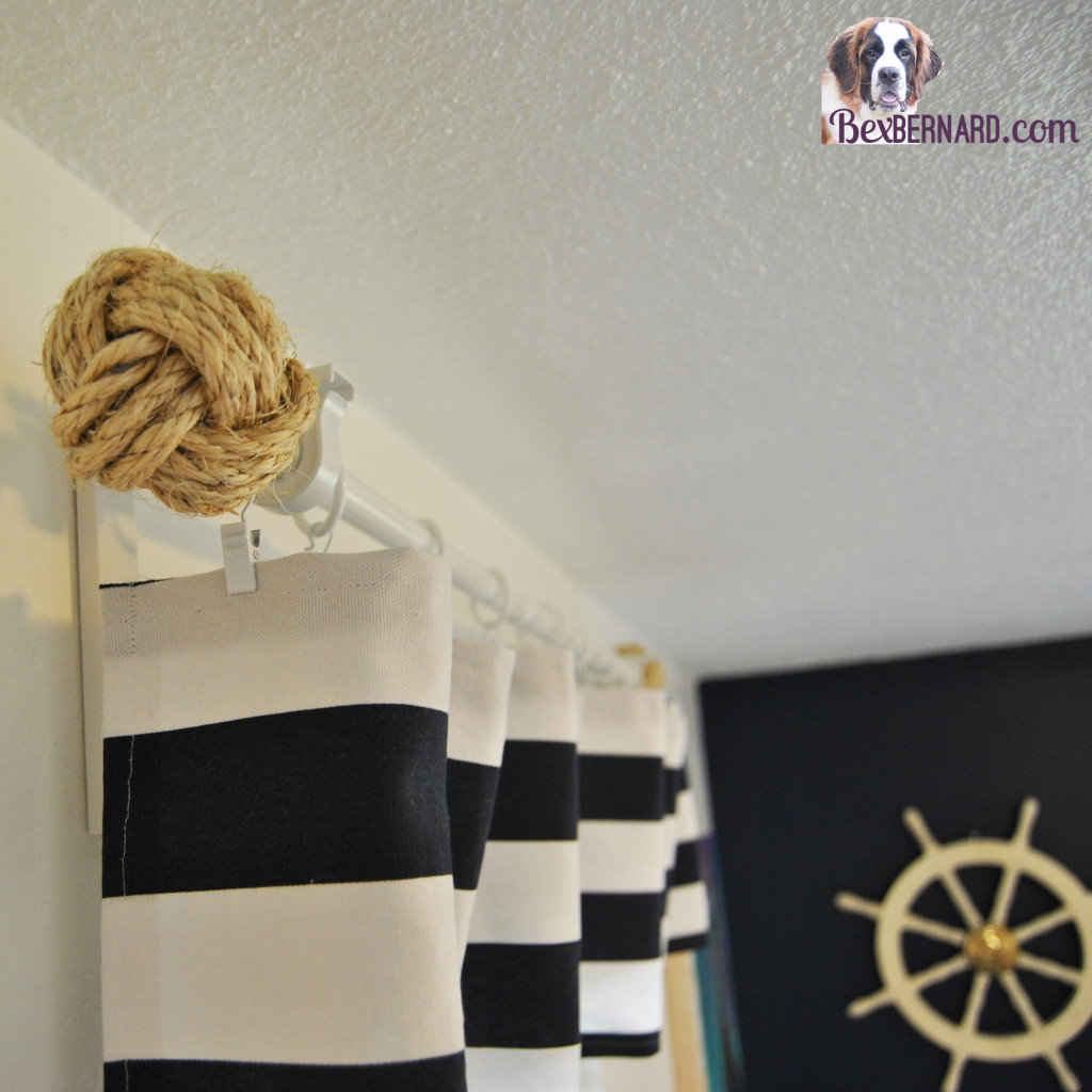 nautical themed bedroom makeover using blue and white home decorations. DIY valance, rope balls, mermaid painting, anchor, helm, lamps. | www.bexbernard.com