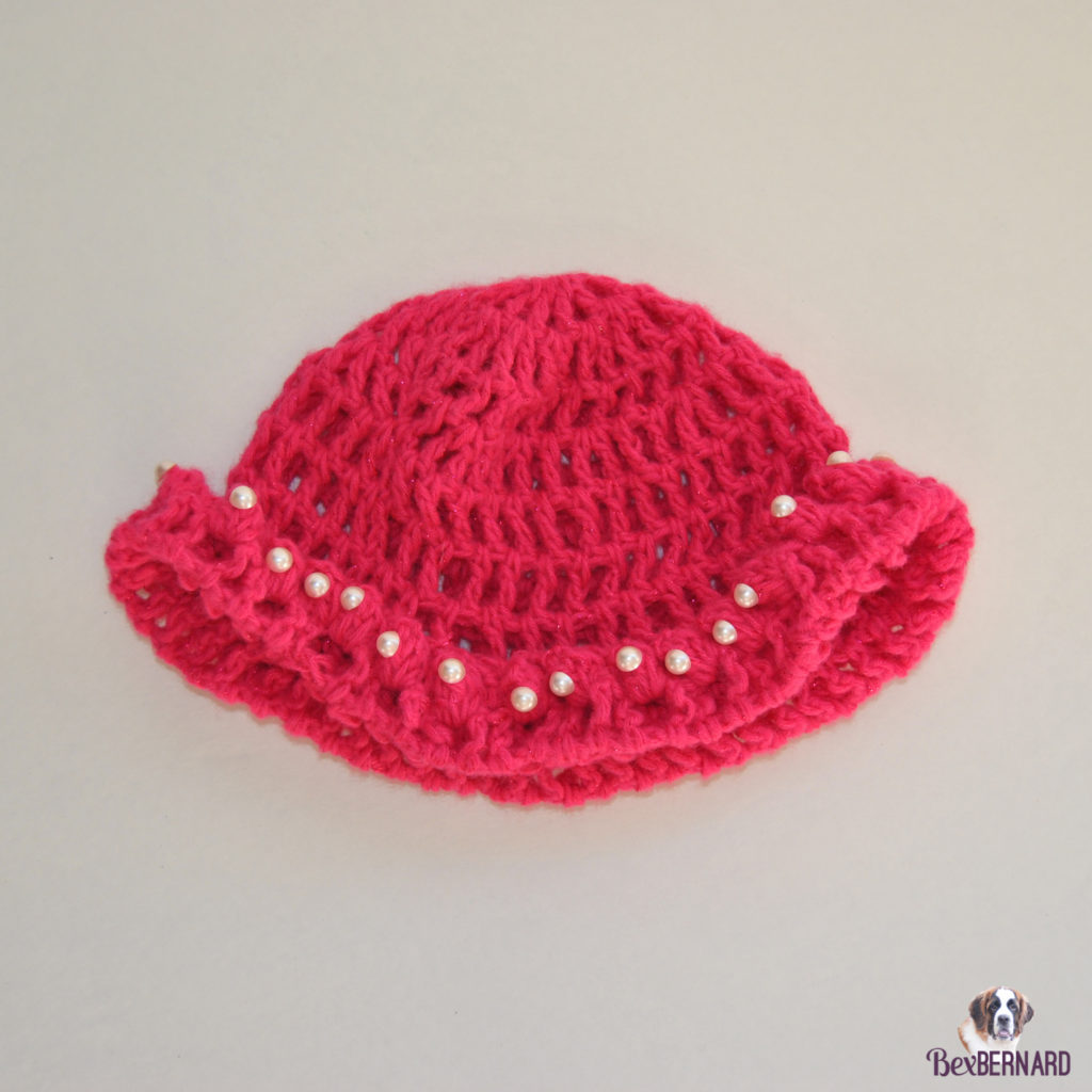 Knitted bright pink hat with pearls. Homemade baby shower gift | bexbernard.com