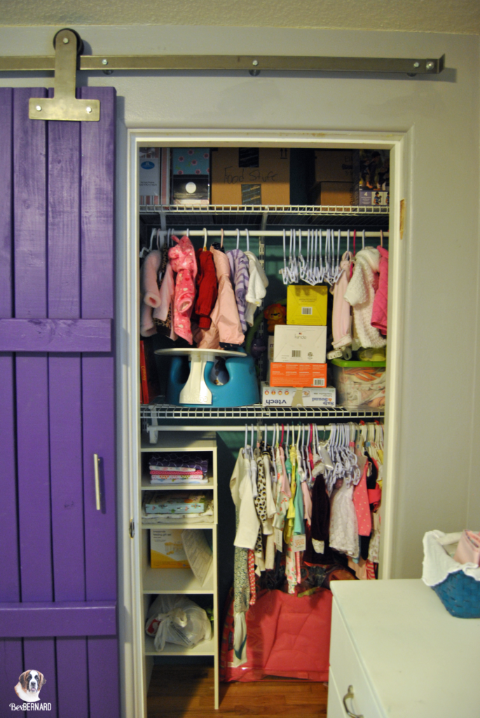 mermaid theme nursery's closet with sliding barn door | bexbernard.com