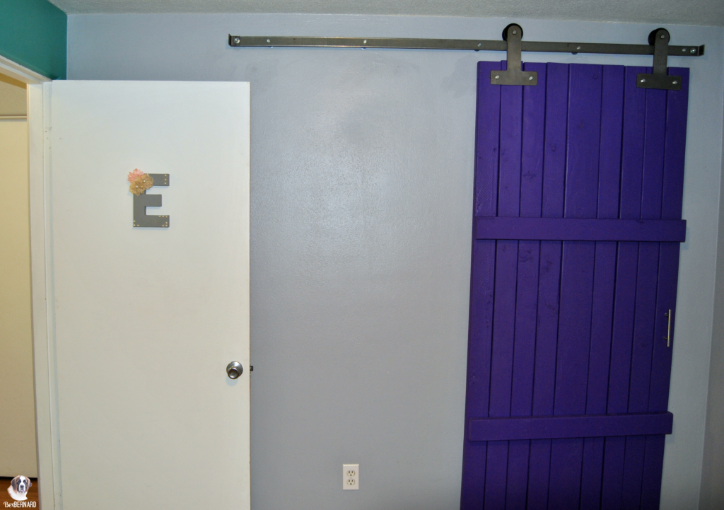 mermaid theme nursery with a purple barn door. sliding barn door for kid's room | bexbernard.com