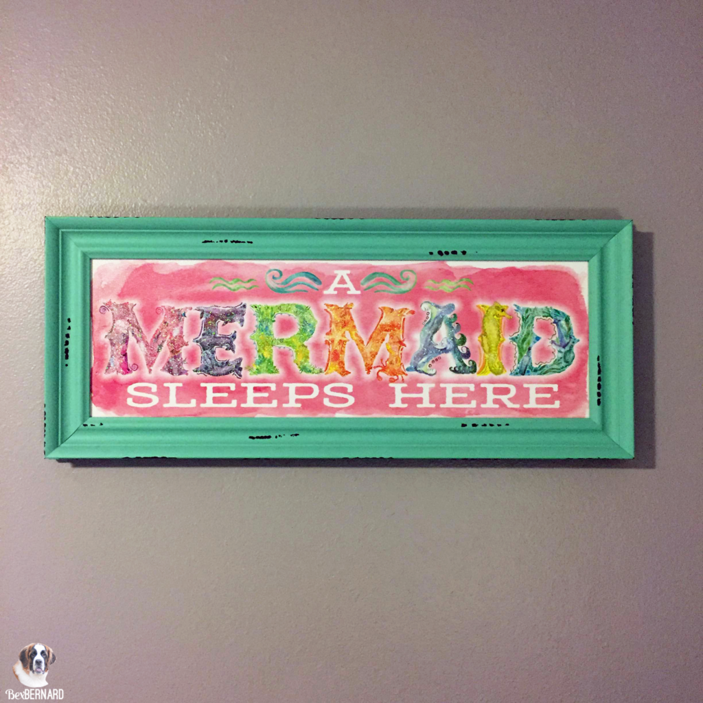 mermaid theme nursery with sign that reads a mermaid sleeps here from Hobby Lobby | bexbernard.com
