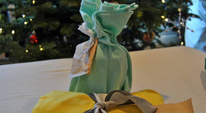 Reusable, green gift wrapping with hand towels, sandwich bags, and snack bags. Eco-friendly way to wrap holiday presents. | bexbernard.com