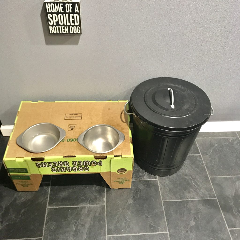Quick, cheap, and easy elevated dog feeder with bowls for food and water.
